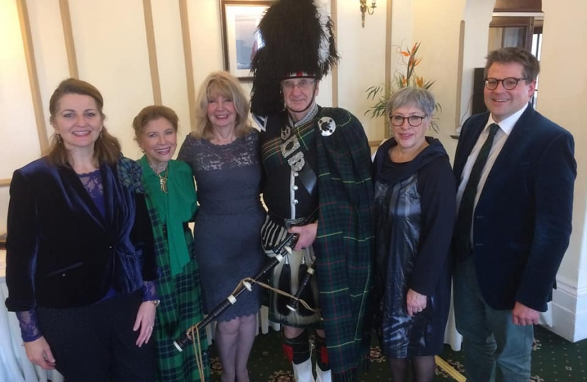 Caroline Ansell, Dame Elaine Montgomerie, Jane Lamb, Ian White (piper), Alison Gibbons, and Will Goodhand.